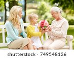 family  holidays and people... | Shutterstock . vector #749548126
