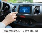 man hand touching to multimedia ... | Shutterstock . vector #749548843