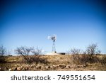 Old Windmill In Desert In Clea...