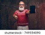 a modern happy senior man...   Shutterstock . vector #749554090