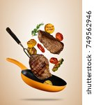 flying beef steaks with grilled ... | Shutterstock . vector #749562946