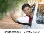 man drive owner car | Shutterstock . vector #749577610