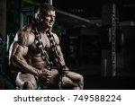 brutal handsome caucasian... | Shutterstock . vector #749588224