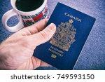 hand holding a canadian passport | Shutterstock . vector #749593150