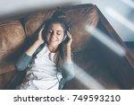 attractive young happy girl... | Shutterstock . vector #749593210