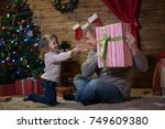 dad and daughter at the... | Shutterstock . vector #749609380