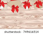 gifts on a wooden background... | Shutterstock .eps vector #749616514