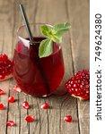 a glass of pomegranate juice... | Shutterstock . vector #749624380