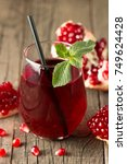 a glass of pomegranate juice... | Shutterstock . vector #749624428