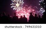 crowd watching fireworks | Shutterstock . vector #749631010