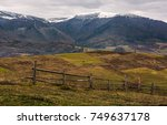 Wooden Fence On Hills Of...