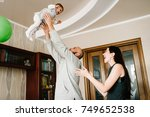 mom cheer  dad holds in hand... | Shutterstock . vector #749652538