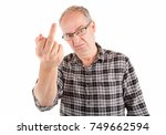 man displeased about something... | Shutterstock . vector #749662594