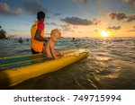 lifeguard with a child on the... | Shutterstock . vector #749715994