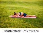 young beautiful girl doing yoga ...   Shutterstock . vector #749740573