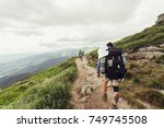 group of hikers with backpacks... | Shutterstock . vector #749745508