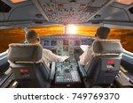 aircraft cockpit in flight. the ... | Shutterstock . vector #749769370