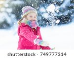 child playing with snow in... | Shutterstock . vector #749777314