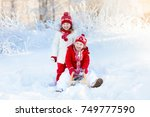 little girl and boy enjoying... | Shutterstock . vector #749777590