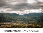 wide mountain range landscape.... | Shutterstock . vector #749779363