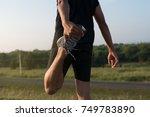 asia young man runner doing... | Shutterstock . vector #749783890
