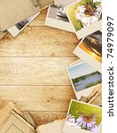 frame with old paper and photos.... | Shutterstock . vector #74979097