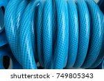 blue water hose.   Shutterstock . vector #749805343