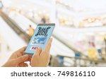 scan the qr code to a smart... | Shutterstock . vector #749816110