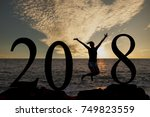 silhouette in 2018 on the hill... | Shutterstock . vector #749823559