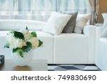 flower vase at center table... | Shutterstock . vector #749830690