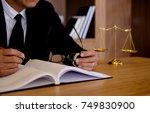 judge gavel with justice... | Shutterstock . vector #749830900