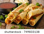 baked taquitos with chicken and ... | Shutterstock . vector #749833138