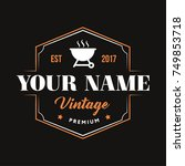 vintage logo with grill symbol... | Shutterstock .eps vector #749853718