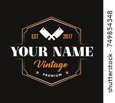 vintage logo with cleaver... | Shutterstock .eps vector #749854348