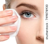 girl removes makeup with... | Shutterstock . vector #749878930