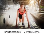 young beautiful athlete on a... | Shutterstock . vector #749880298