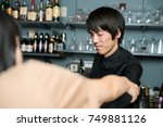 man entangled by female customer | Shutterstock . vector #749881126