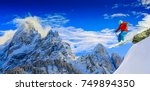 skiing with amazing panorama of ... | Shutterstock . vector #749894350
