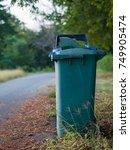 row of wheelie bins and opening ... | Shutterstock . vector #749905474