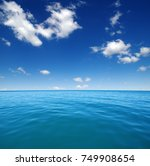 blue sea water surface on sky | Shutterstock . vector #749908654