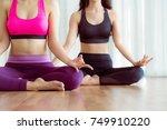 women practicing yoga pose in... | Shutterstock . vector #749910220