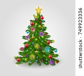 the christmas tree is decorated ... | Shutterstock . vector #749923336