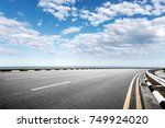 empty asphalt road and... | Shutterstock . vector #749924020