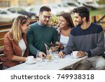 group of four friends having... | Shutterstock . vector #749938318