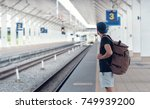 young traveler walking with... | Shutterstock . vector #749939200