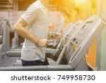 people running in machine... | Shutterstock . vector #749958730