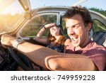 couple in a car at sunset  with ... | Shutterstock . vector #749959228