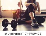 Woman Exercise Workout In Gym...