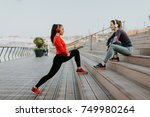 young woman exercising with a... | Shutterstock . vector #749980264