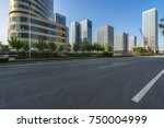 empty asphalt road with city... | Shutterstock . vector #750004999